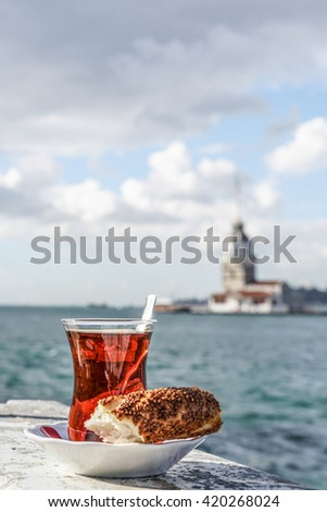 Turkish tea and bagel against sea and Maidens Tower in istanbul, Turkey - stock photo