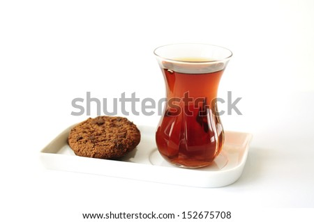 Turkish tea in traditional glass with cookies - stock photo