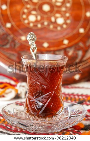 Turkish tea in traditional glass with oriental background