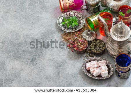 Turkish tea table with delights. Oriental hospitality. Ramadan kareem. Islamic holidays. Selective focus - stock photo