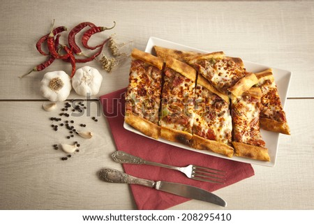 Turkish traditional beef and cheese Pide - stock photo