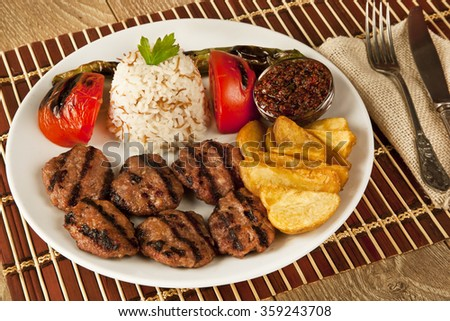 Turkish traditional home made kofta meatball with pilaf pilav and potatoes - stock photo