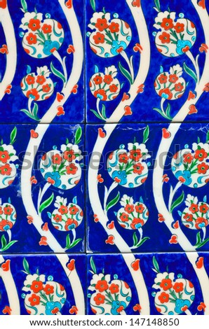 Turkish wall tile background with tulips. - stock photo