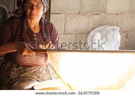 Turkish woman making a traditional bread
