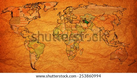 turkmenistan flag on old vintage world map with national borders - stock photo