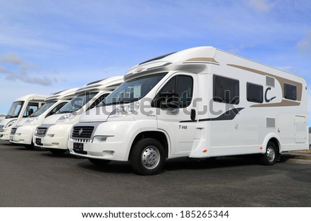 TURKU, FINLAND - MARCH 30, 2014: Fiat Carado and Hymer recreational vehicles in a row. In Finland, about 1000 new camper vans are registered annually. - stock photo