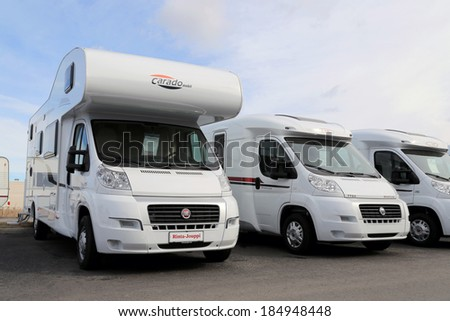 TURKU, FINLAND - MARCH 30, 2014: Fiat Carado and LMC recreational vehicles parked in a row. Starting January 2014, Euro 5b+ emission standards involve RV??s and vans. - stock photo
