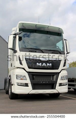 TURKU, FINLAND - SEPTEMBER 15, 2013:  MAN TGX 26.480 Euro 6 truck tractor parked. According to the TUV Report 2014, MAN is the most reliable brand of trucks weighing over 7.5 tonnes.  - stock photo