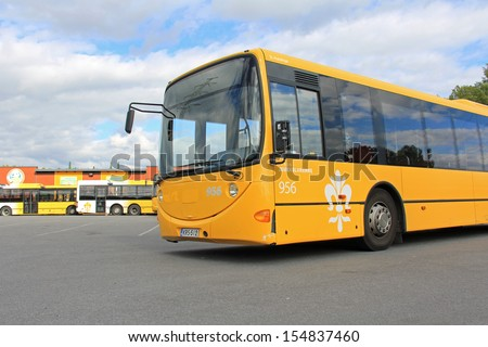TURKU, FINLAND - SEPTEMBER 15: Yellow city bus on September 15, 2013 in Turku, Finland. On the World Car-Free Day 22 September, local bus fares in Finnish cities are considerably reduced.  - stock photo