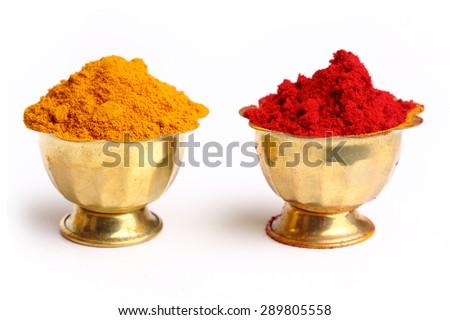 Turmeric and kumkum powder - stock photo
