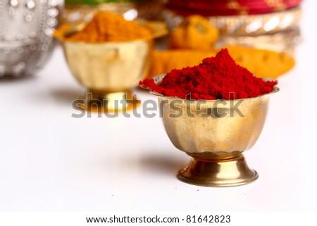 Turmeric and kumkum powder arrangements - stock photo