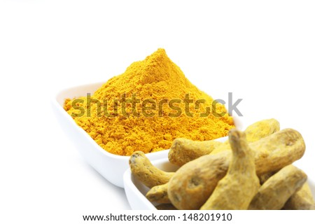 Turmeric and Turmeric Powder in a square Bowl isolated on a white background.