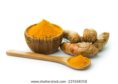 Turmeric and turmeric powder on white background - stock photo