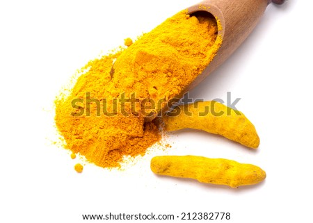 Turmeric barks and powder in wooden scoop isolated on white background