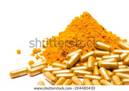Turmeric capsule powder. - stock photo