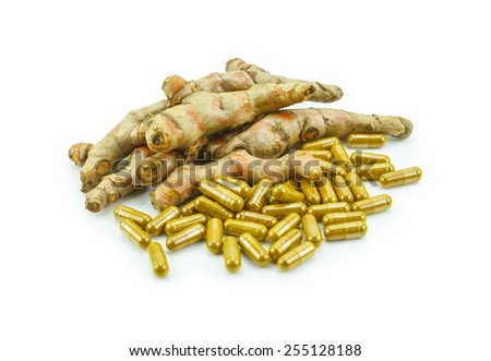 Turmeric (Curcuma longa L.) root and turmeric capsule powder for alternative medicine ,spa products and food ingredient. - stock photo