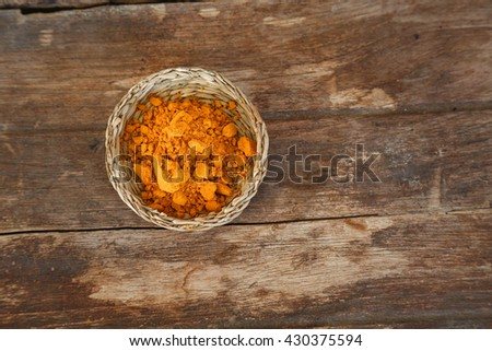 Turmeric powder and turmeric on wooden background - stock photo