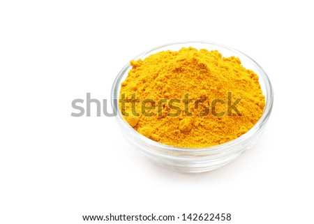Turmeric Powder in a glass Bowl isolated on a white background.