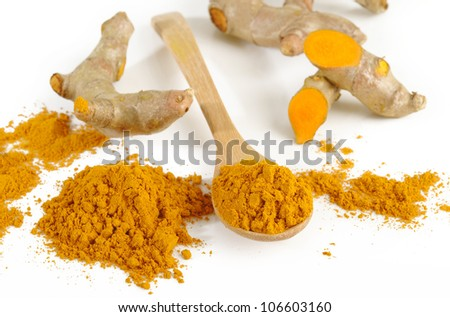 turmeric powder in wooden spoon - stock photo