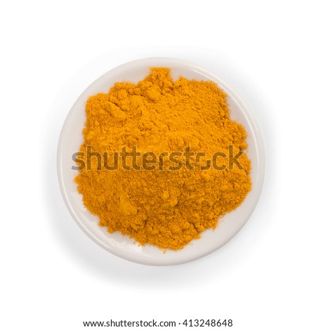 Turmeric powder isolated on white background.