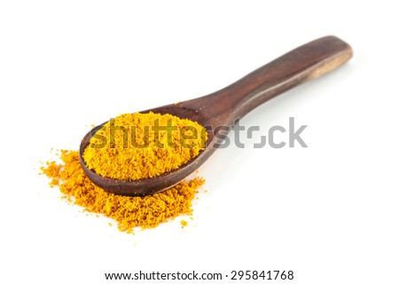 Turmeric powder on a wooden spoon isolated on white background - stock photo