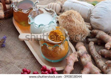Turmeric powder with honey and milk for scrub - stock photo
