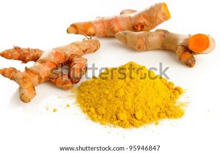 Turmeric root and powder on white background - stock photo