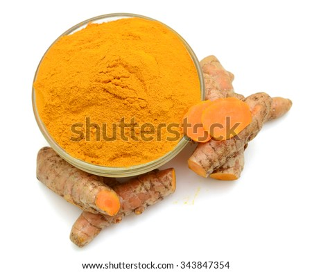 Turmeric roots and powder on white background - stock photo