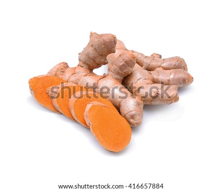 Turmeric roots on white background - stock photo