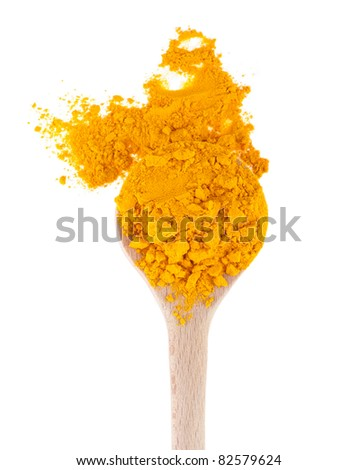 turmeric spice on a wooden spoon, isolated on white background - stock photo
