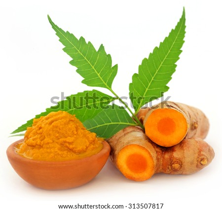 Turmeric with neem leaves over white background