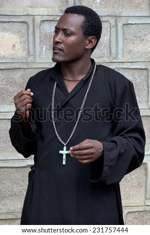TURMI, ETHIOPIA - NOVEMBER 22, 2011: The priest from the Ethiopian orthodox church. November 22, 2011 in Turmi, Ethiopia. - stock photo