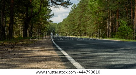 turn field road in the summer forest - stock photo