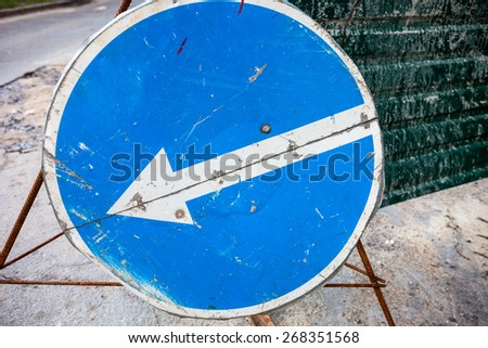 Turn left sign with scratched surface. Close up. - stock photo