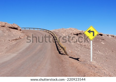 Turn left signal at Moon Valley - Valle de la Luna - Atacama Desert, Chile - stock photo