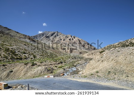 Turn of mountain road - stock photo
