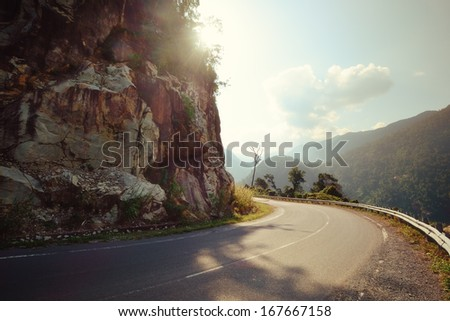 Turn of rural mountain highway in Mexico - stock photo