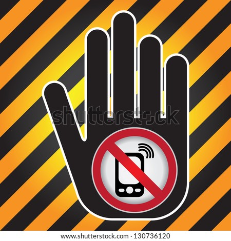 Turn Off Your Mobile Phone or Mobile Phone Are Not Allowed Prohibited Sign Present By Hand With Mobile Phone Are Not Allowed Prohibited Sign Inside in Caution Zone Dark and Yellow Background - stock photo