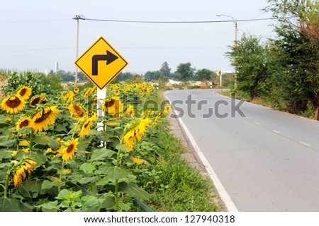 Turn right warning sign on a curve road - stock photo