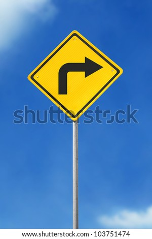 turn right yellow road sign on sky background - stock photo