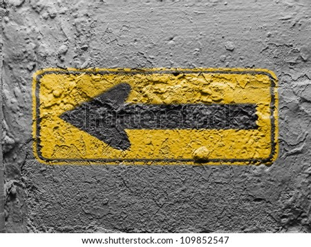 Turn road sign painted on grunge wall