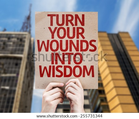 Turn Your Wounds Into Wisdom card with urban background - stock photo