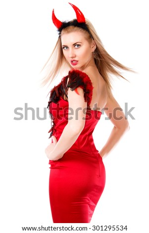 Turning around young woman in a devil costume isolated over white background - stock photo