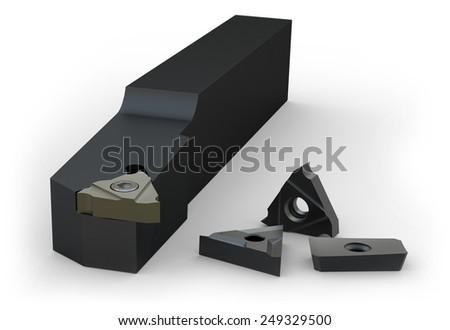 Turning holder and inserts isolated on white - stock photo