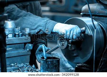 Turning lathe in the workshop in closeup - stock photo