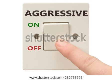 Turning off Aggressive with finger on electrical switch - stock photo