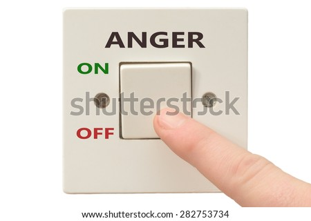 Turning off Anger with finger on electrical switch - stock photo