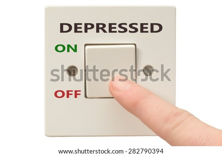 Turning off Depressed with finger on electrical switch - stock photo