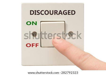 Turning off Discouraged with finger on electrical switch
