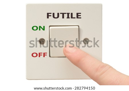 Turning off Futile with finger on electrical switch - stock photo